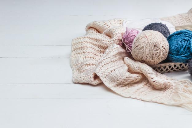 balls-wool-white-wooden-surface_155003-11507