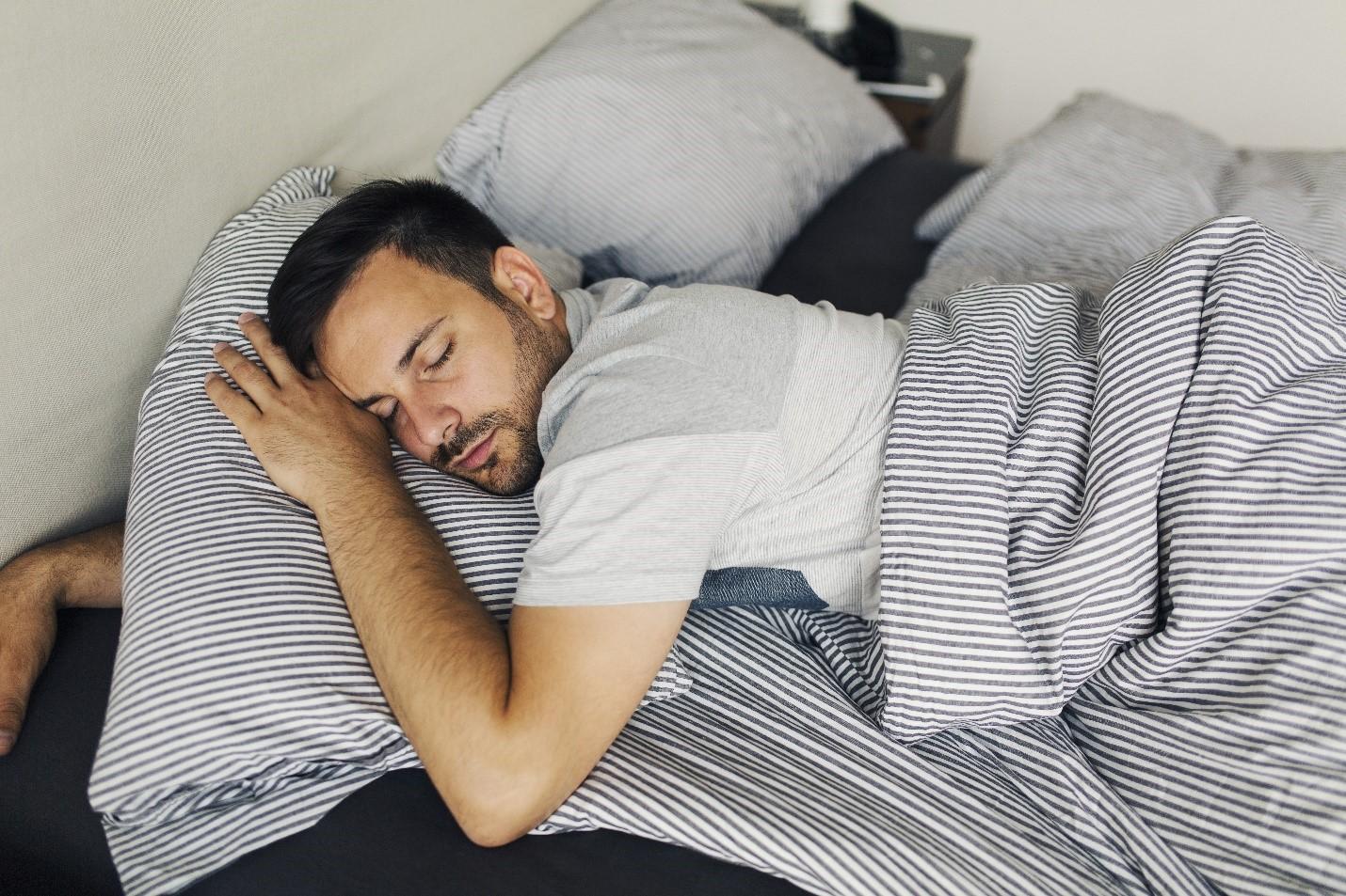 man-sleeping-alone